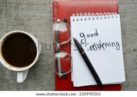 red e-book,Notepad,reading glasses,hot Cup of coffee on wooden background - stock photo