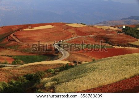 Red earth farmland in Dongchuan, China - stock photo