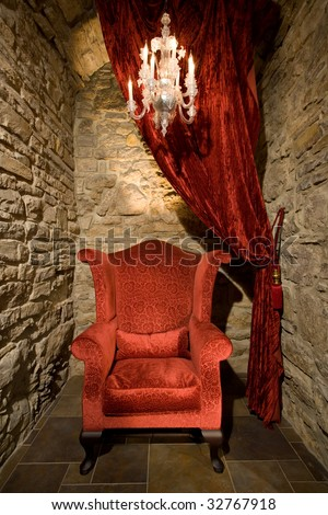 red easy chair in old interior - stock photo