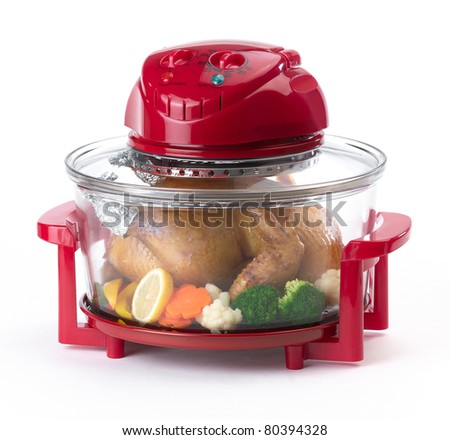 Red electric convection oven for more comfortable cooking - stock photo