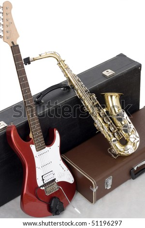 Red electric guitar and gold sax  isolated on white - stock photo