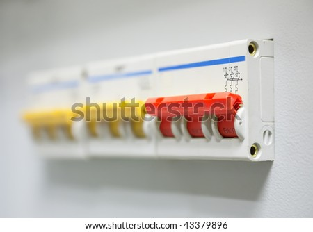 Red electrician circuit breaker on control panel - stock photo