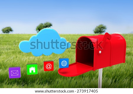 Red email postbox against green meadow - stock photo
