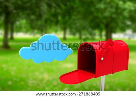 Red email postbox against park - stock photo
