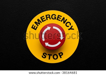Red emergency button on black panel - stock photo