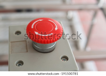 Red emergency stop switch reset button - stock photo