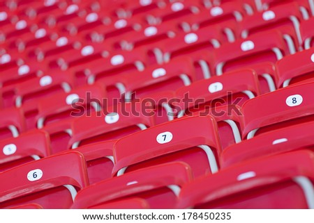 red empty seats in stadium - stock photo