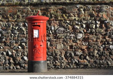 Red English pillar box or post box. - stock photo