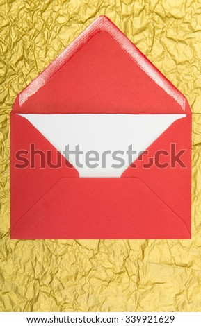 red envelope and on golden background, christmastime - stock photo
