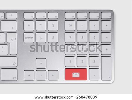 Red envelope button concept on metallic keyboard - stock photo