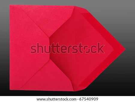 Red envelope isolated on the grey-black surface. - stock photo