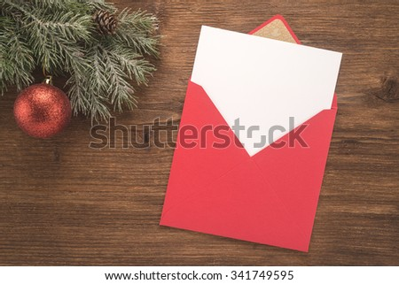 Red envelope on christmas holiday background   - stock photo