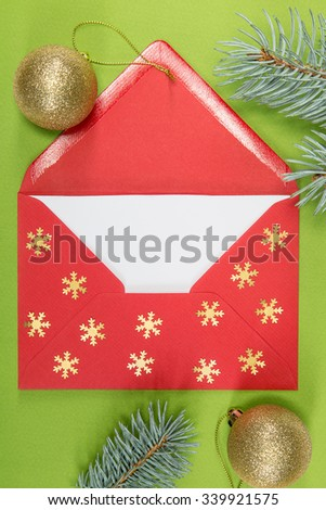 red envelope on green background and chritmas ball, christmastime - stock photo