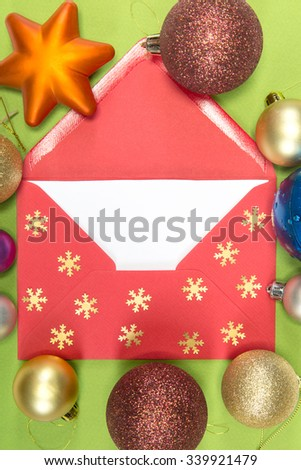 red envelope on green background, christmastime - stock photo