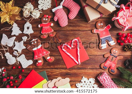 Red envelope on the table, waiting for Christmas greeting card - stock photo