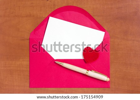 Red envelope with little heart and letter for your own text  - stock photo