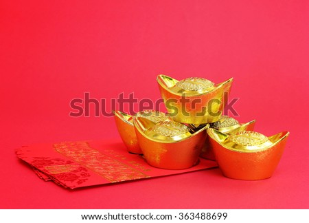 Red envelopes and Gold for Chinese New Year on red background - stock photo