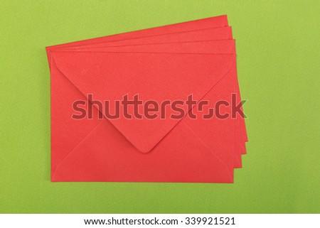 red envelopes on green background, christmastime - stock photo