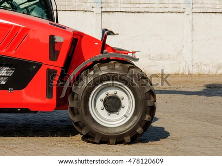 red excavator parked. Large bucket. Construction machinery