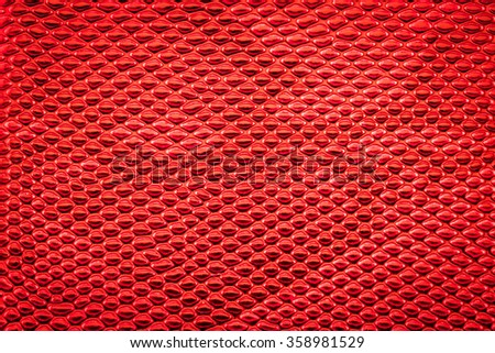 Red exotic Snake skin pattern as a wallpaper - stock photo