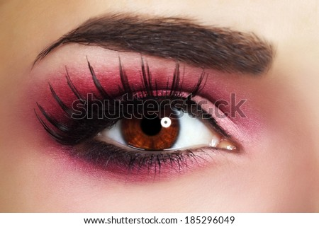Red Eye Makeup. Beautiful eye makeup close up - stock photo