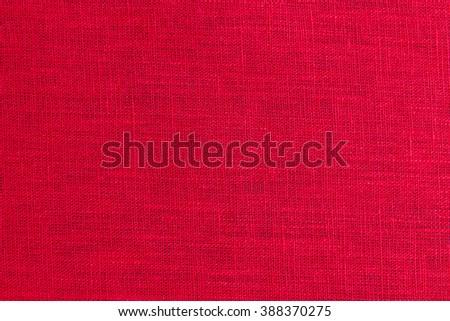 Red fabric closeup flax linen burlap texture - stock photo