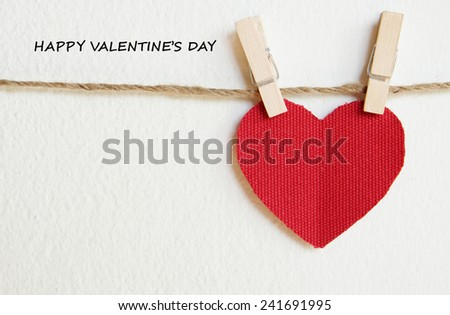 Red fabric heart with happy valentine's day 2015 words hanging on the clothesline, valentine background template - stock photo