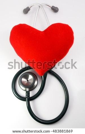 Red fabric heart with stethoscope
