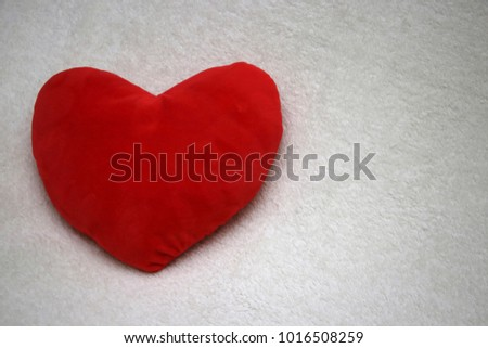 red fabric heart with white background