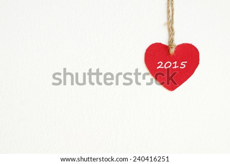 Red fabric heart with 2015 word hanging on the clothesline, new year template - stock photo