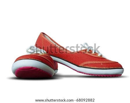 Red fabric shoes isolate on white background with shadow
