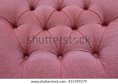 Red fabric sofa texture background. Vintage