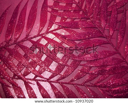 red fabric texture and leaves for background