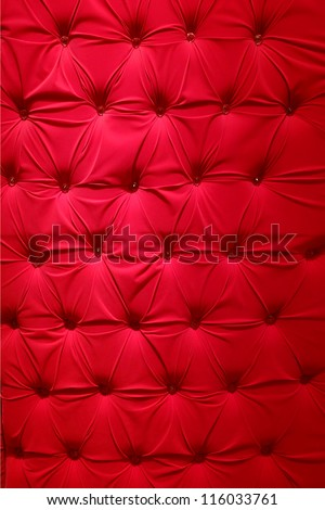 Red fabric upholstery - stock photo