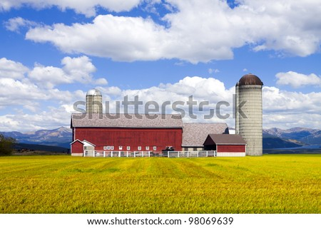 Red Farm in Colorado with Cloudy Sky - stock photo