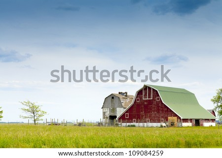 Red Farm With Cloudy Rainy Sky - stock photo
