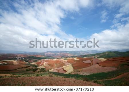 red farmland,yunnan,china - stock photo