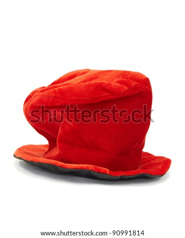 Red felt Christmas hat on a white background