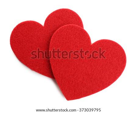 Red felt hearts isolated on white background - stock photo