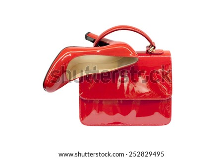 Red female bag&shoes on white background. - stock photo