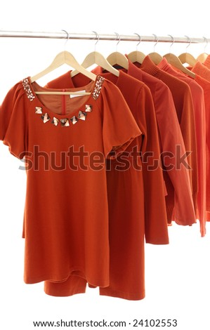 Red female jacket on Hangers - stock photo
