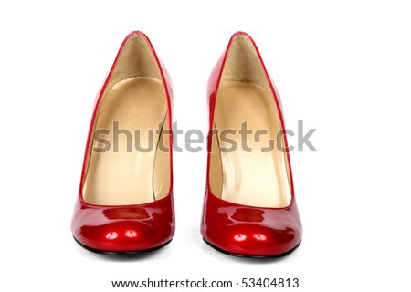 Red female shoes on a high heel. It is isolated on a white background - stock photo