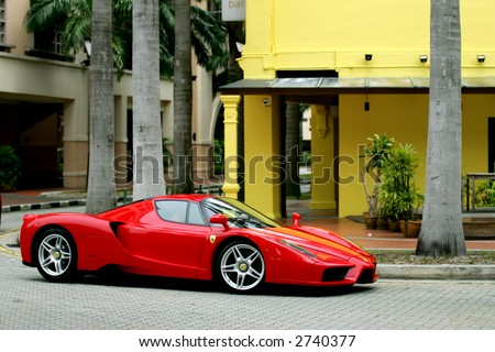 Red Ferrari Enzo in Chinatown of Singapore - stock photo