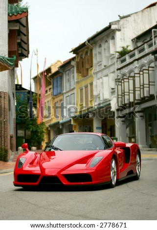 Red Ferrari Enzo in Singapore's Chinatown - stock photo