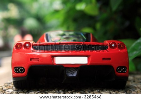 Red Ferrari outdoors - stock photo