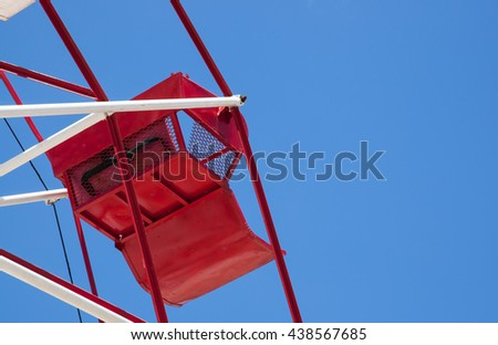 Red ferris wheel against a sky background - stock photo