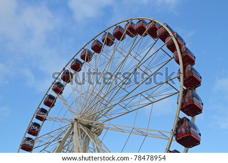 Red Ferris Wheel with blue sky as the background - stock photo