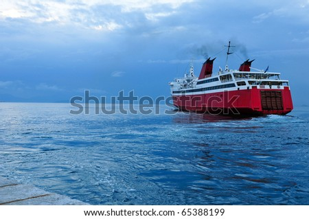 red ferryboat on blue see