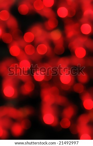Red, festive blurred lights as a background.