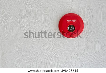 Red Fire alarm on white wall - stock photo